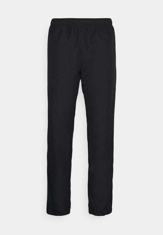 TENNIS PANT TAPERED - Pantalon de survêtement - black/white
