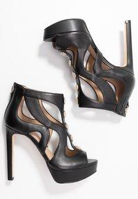 Guess - CABELLS - Platform heels - black - 3