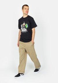 HUF - Print T-shirt - black - 1