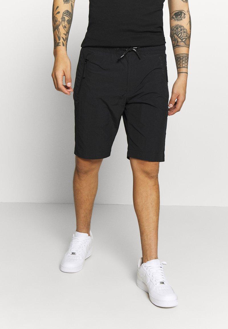 Calvin Klein - REGULAR FIT CRINKLE - Trainingsbroek - black