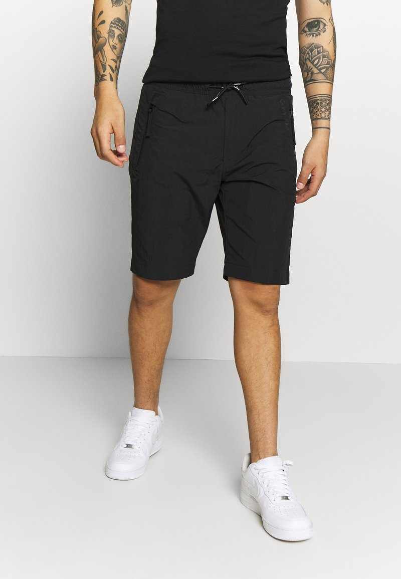Calvin Klein - REGULAR FIT CRINKLE - Teplákové kalhoty - black