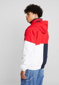 Karl Kani - RETRO BLOCK WINDBREAKER - Summer jacket - red/black/white - 2