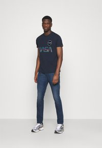 Diesel - D-STRUKT - Jeans Skinny Fit - dark blue - 1