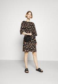 Marimekko - ILMAAN MINI UNIKKO DRESS - Shift dress - brown/black - 1