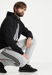 adidas Performance - MUST HAVES SPORT TIRO SLIM FIT PANT - Verryttelyhousut - medium grey heather/black - 1