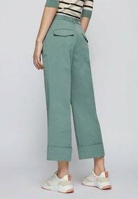 BOSS - TAROMA - Trousers - light green - 2