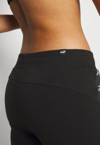 Puma - AMPLIFIED - Tracksuit bottoms - black - 4