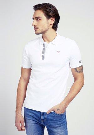 LOGO-DREIECK - Polo shirt - weiß