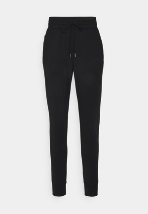 BACK YOKE - Tracksuit bottoms - true black