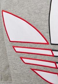 adidas Originals - UNISEX - Tracksuit bottoms - grey - 3