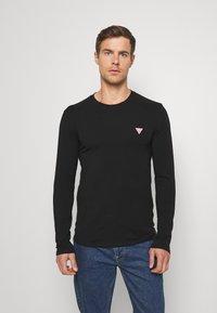 Guess - CORE TEE - T-shirt à manches longues - jet black - 0