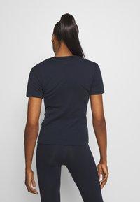 Champion - CREWNECK LEGACY - Print T-shirt - dark blue - 2