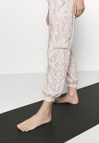 Free People - RISE TO THE SUN PRINTED - Tracksuit bottoms - pink - 3
