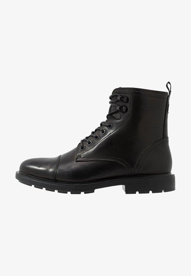NIGONIEL - Lace-up ankle boots - black