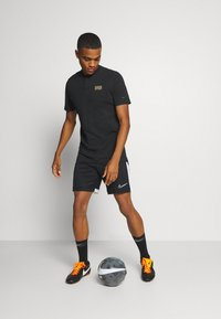 Nike Performance - MODERN - Article de supporter - black/metallic gold - 1