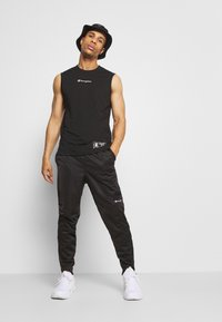 Champion - LEGACY CUFF PANTS - Pantalon de survêtement - black - 1