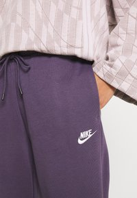 Nike Sportswear - Tracksuit bottoms - dark raisin/white - 4