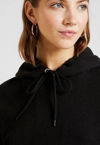 Monki - ODA URGENT - Jersey con capucha -  black - 4