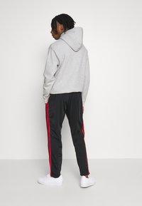 adidas Originals - SUPERSTAR 3STRIPES TRACK PANTS - Träningsbyxor - black/red - 2