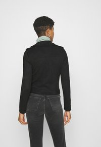 Vero Moda - VMBOOSTBIKER SHORT JACKET - Faux leather jacket - black - 2