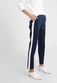 HUGO - HERANI - Trousers - open blue - 0