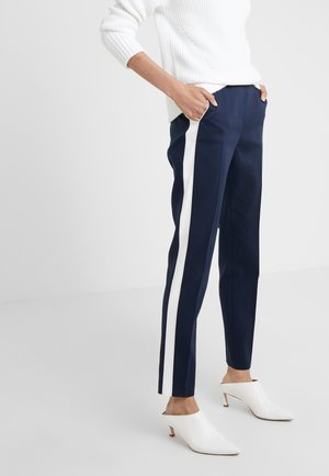 HERANI - Trousers - open blue