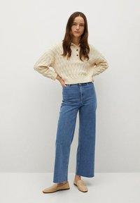 Mango - CATHERIN - Flared Jeans - middenblauw - 1
