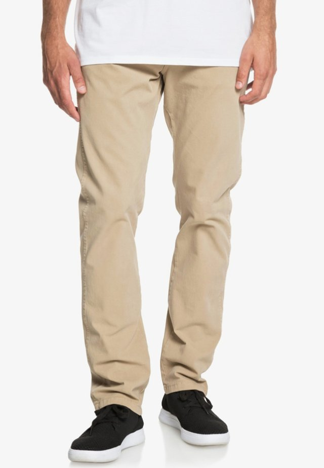 KRANDY - Trousers - brown