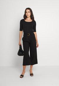 Vero Moda - VMORLA PANTS - Trousers - black - 1