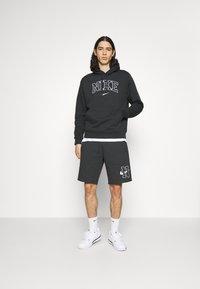 Nike Sportswear - RETRO HOODIE - Sweatshirt - off noir - 1