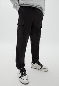 PULL&BEAR - Cargo trousers - black - 0