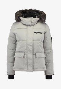 SHORT SKI PUFFER - Winter jacket - pale grey