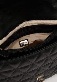 Guess - LAIKEN SHOULDER BAG - Handbag - black - 4