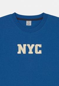 Lindex - OVERSIZE NYC - Print T-shirt - blue - 2