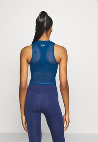 Nike Performance - PRINTED TANK PALM - Top - light thistle/valerian blue/white