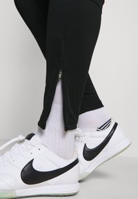 Nike Performance - ACADEMY 21 PANT - Tracksuit bottoms - black/siren red - 4