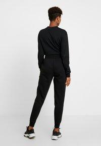 Nike Sportswear - SHINE - Tracksuit bottoms - black/metallic - 3