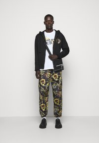 Versace Jeans Couture - MAN TROUSER - Tracksuit bottoms - nero - 1