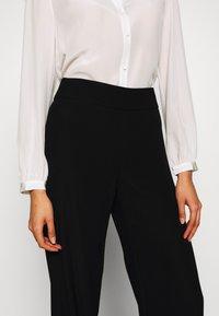 Emporio Armani - TROUSER - Trousers - black - 5