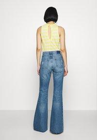 Ética - NINA - Flared Jeans - destroyed denim - 2