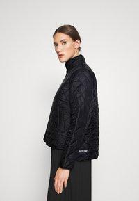 Selected Femme - SLFPLASTICCHANGE QUILTED JACKET - Light jacket - black - 3