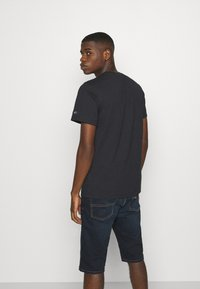 Tommy Jeans - REGULAR CORP LOGO CNECK - Basic T-shirt - black - 2