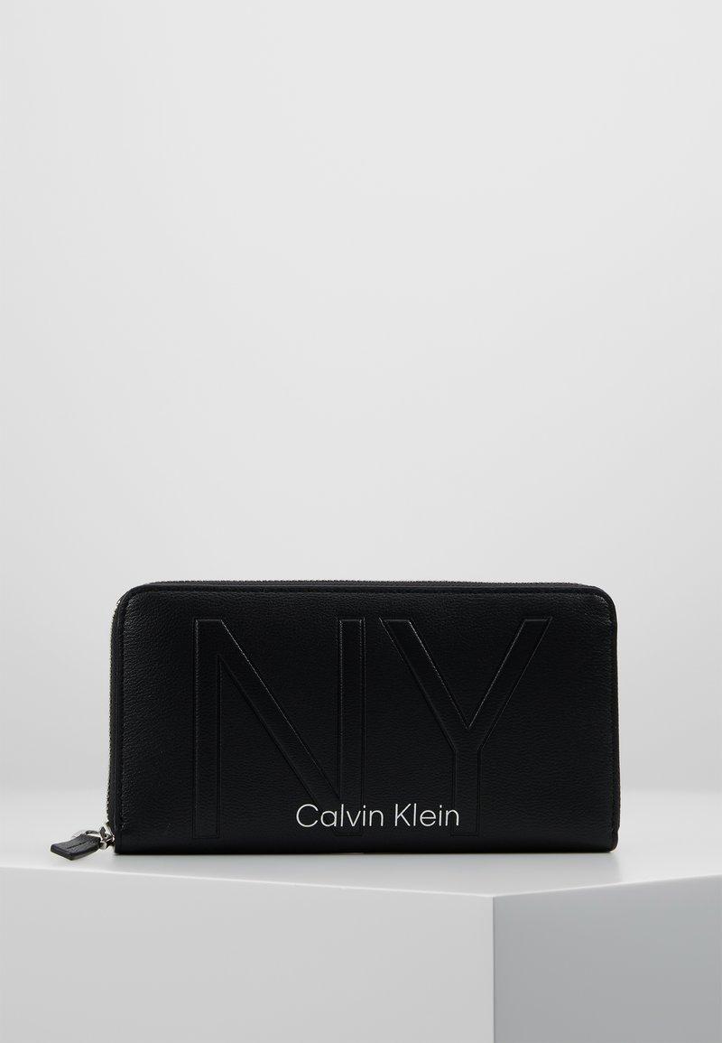 Calvin Klein - SHAPED ZIPAROUND - Portefeuille - black