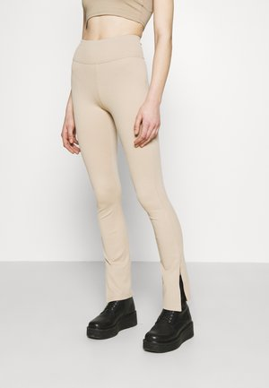 YARA SLIT - Leggings - Trousers - sand