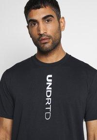 Under Armour - CURRY HEAVYWEIGHT TEE - Sports shirt - black - 3