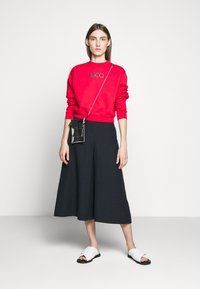 McQ Alexander McQueen - TROUSERS - Trousers - deep ink - 1