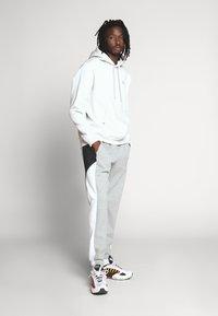Nike Sportswear - Tracksuit bottoms - dark grey heather/white/black - 1