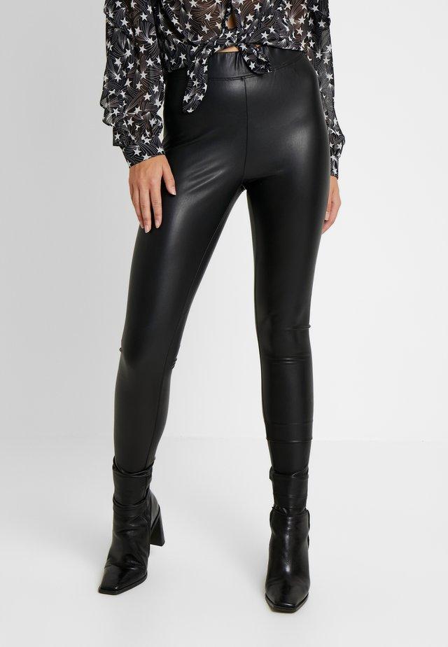 ONLSUPER STAR - Leggings - Trousers - black