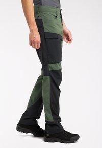 Haglöfs - Outdoor trousers - fjell green/true black - 2