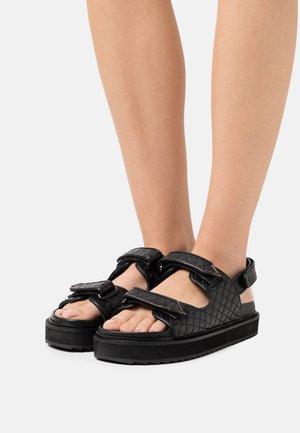 SOLOMON - Korkeakorkoiset sandaalit - black
